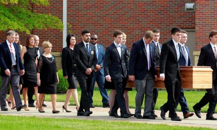 Fred and Cindy Warmbier follow their son's, Otto Wambier, casket to the hearse after his funeral at Wyoming High School in Wyoming, Ohio, U.S. June 22, 2017.  (John Sommers II/Reuters)