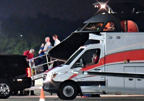 A person believed to be Otto Warmbier is transferred from a medical transport airplane to an awaiting ambulance at Lunken Airport in Cincinnati, Ohio, U.S., June 13, 2017.  (Bryan Woolston/Reuters)