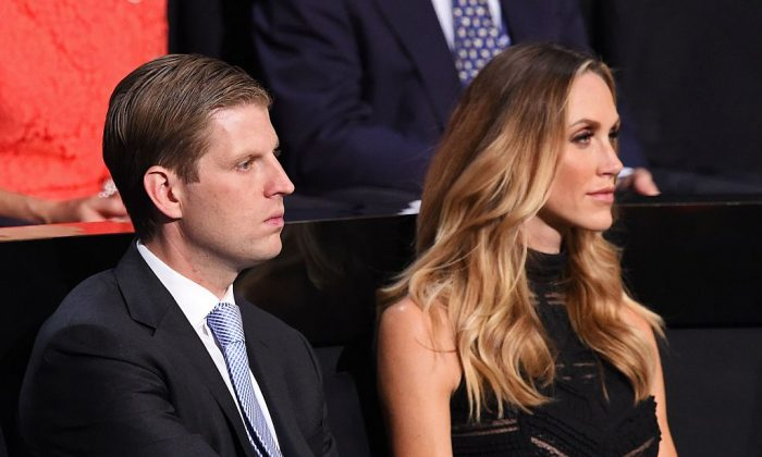 Donald Trump's son Eric Trump and his wife Lara Yunaska attend the final night at the Republican National Convention at the Quicken Loans Arena in Cleveland, Ohio on July 21, 2016. (ROBYN BECK/AFP/Getty Images)