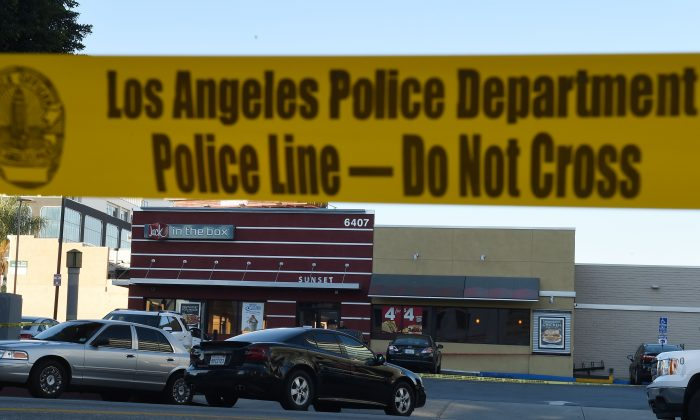 Police tape cordons off an area outside a Jack in the Box restaurant in Hollywood, California, January 31, 2017.   (ROBYN BECK/AFP/Getty Images)