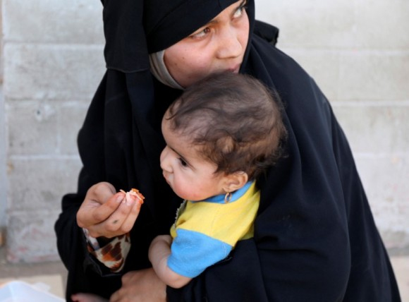 A woman feeds her baby after fleeing Mosul's Old City, the last district in the hands of Islamic State militants, during fighting between Iraqi forces and Islamic State militants in western Mosul, Iraq June 24, 2017. (Reuters/Marius Bosch)