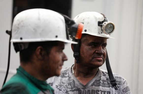 Rescue personnel look on as they coordinate to search for missing miners after an explosion at an underground coal mine on Friday, in Cucunuba, Colombia June 24, 2017. (Reuters/Jaime Saldarriaga)
