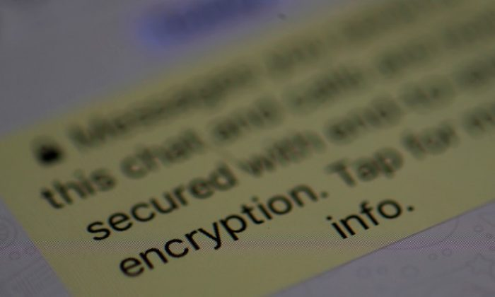 An encryption message is seen on the  WhatsApp application on an iPhone in Manchester , Britain March 27, 2017. (Reuters/Phil Noble)