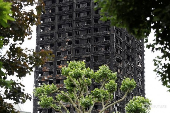 Damage to Grenfell Tower is seen following the catastrophic fire, in north Kensington, London, Britain, June 25, 2017.  (Reuters/Peter Nicholls)