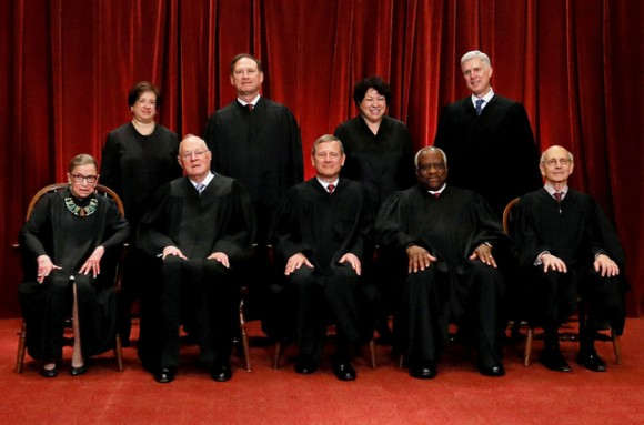 FILE PHOTO: U.S. Chief Justice John Roberts (seated C) leads Justice Ruth Bader Ginsburg (front row, L-R), Justice Anthony Kennedy, Justice Clarence Thomas, Justice Stephen Breyer, Justice Elena Kagan (back row, L-R), Justice Samuel Alito, Justice Sonia Sotomayor, and Associate Justice Neil Gorsuch in taking a new family photo including Gorsuch, their most recent addition, at the Supreme Court building in Washington, D.C., U.S., on  June 1, 2017. REUTERS/Jonathan Ernst/File Photo