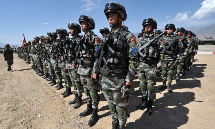 Chinese soldiers stand at attention during Peace Mission-2016 joint military exercises of the Shanghai Cooperation Organization (SCO) in the Edelweiss training area in Balykchy some 200 km from Bishkek on September 19, 2016. (VYACHESLAV OSELEDKO/AFP/Getty Images)