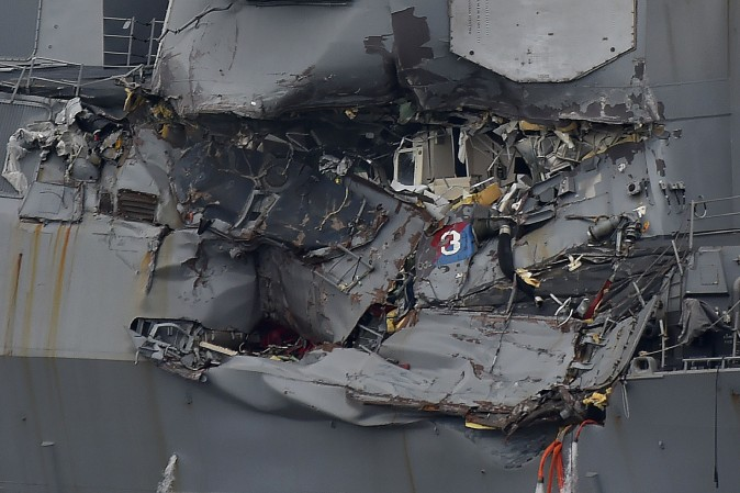 Damage to the guided missile destroyer USS Fitzgerald is seen as the vessel is berthed at its mother port in Yokosuka, southwest of Tokyo, on June 18, 2017. (Kazuhiro Nogi/AFP/Getty Images)