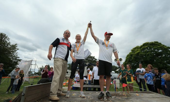 Julie Moens (C) and Tyler Hislop of Canada celebrate Moens's victory in the final of the Russian Roulette discipline during the 2017 World Egg Throwing Championships at Swaton Vintage Fair in Lincolnshire, England on June 25, 2017.   (LINDSEY PARNABY/AFP/Getty Images)