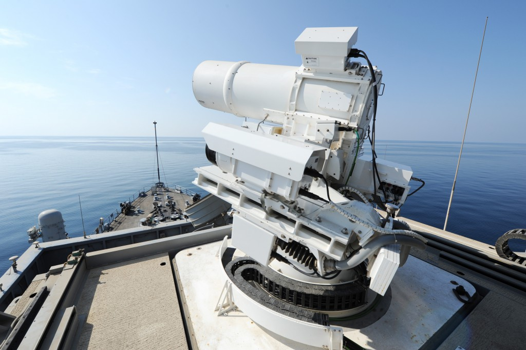 The USS Ponce conducts an operational demonstration of the Laser Weapon System while deployed to the Arabian Gulf. (U.S. Navy photo by John F. Williams/Released)