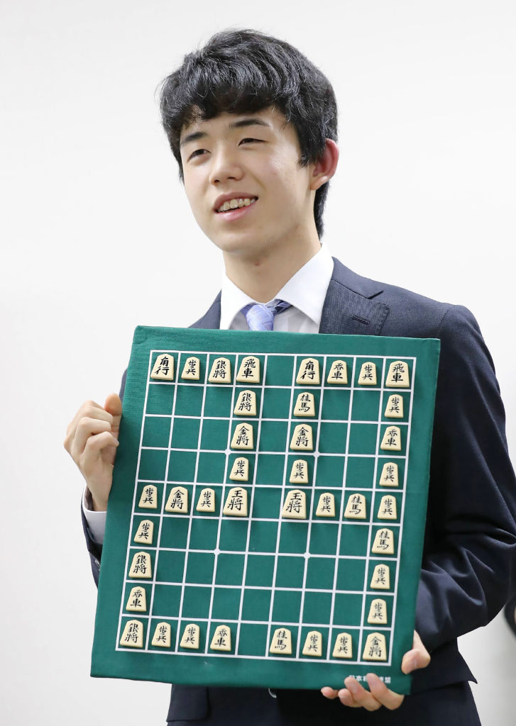 Junior high school student Sota Fujii posing for photographers in Tokyo on June 26, 2017. (STR/AFP/Getty Images)