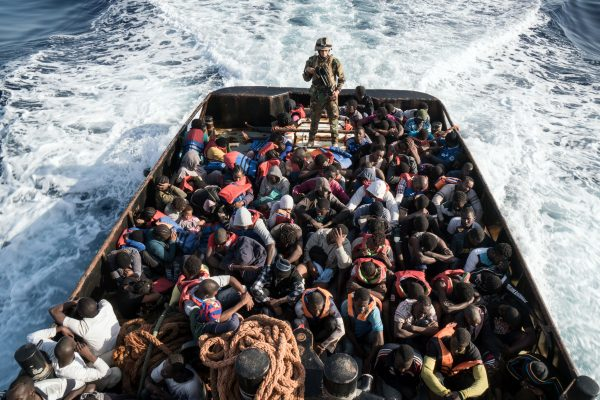 A Libyan coast guardsman on a boat