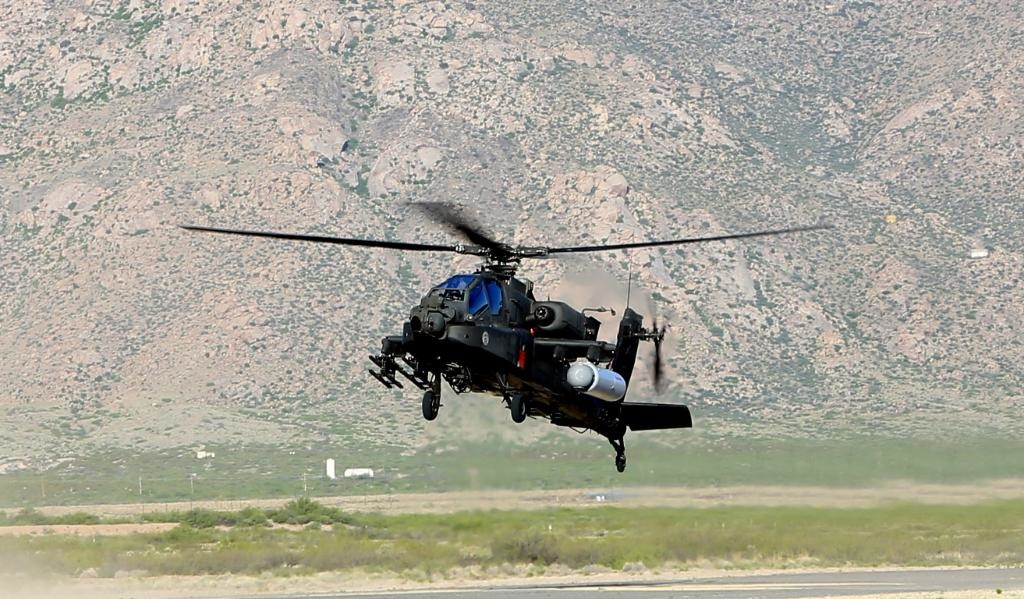 An Apache helicopter with a mounted laser weapon. (Raytheon)