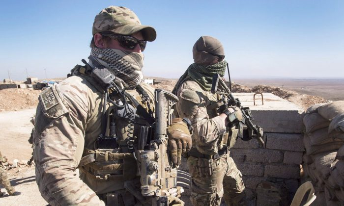 Two members of the Canadian special forces look over a Peshmerga observation post on Feb. 20, 2017, in northern Iraq. (The Canadian Press/Ryan Remiorz)