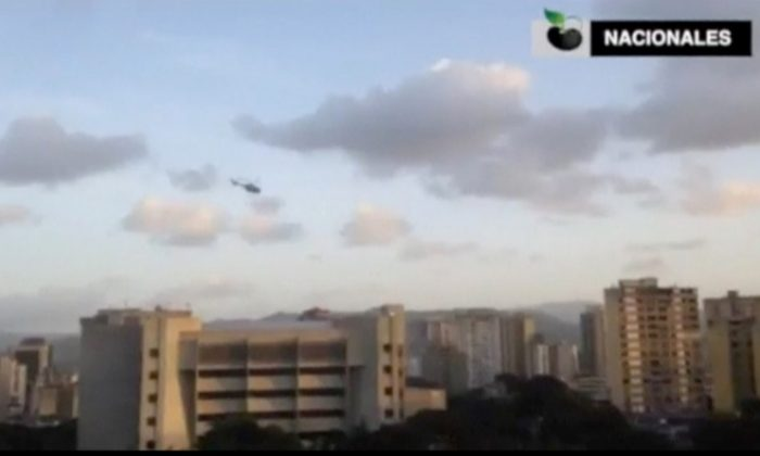 A police helicopter flies over Venezuela's Supreme Court building in Caracas June 27, 2017, in this still image taken from a video. (Caraota Digital/Handout via Reuters)
