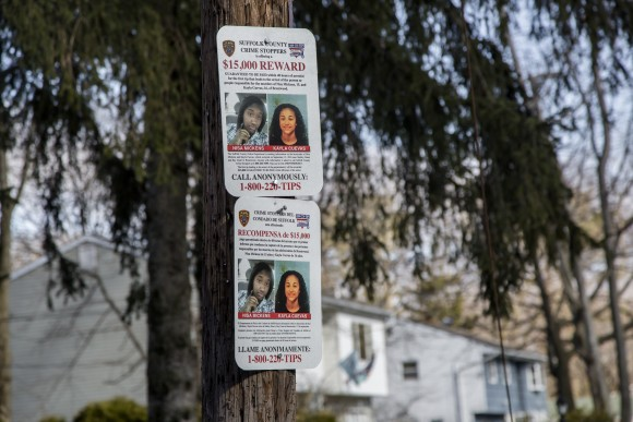 A sign offering a reward for information regarding the murder of Nisa Mickens and Kayla Cuevas, near Brentwood High School where they studied, in Brentwood, Suffolk County, New York, on March 29, 2017. (Samira Bouaou/The Epoch Times)