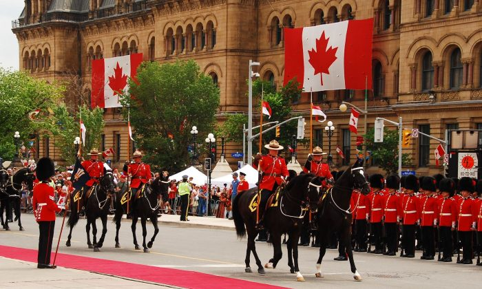 The RCMP take part in a Canada Day parade in Ottawa on July 1, 2016. (Jonathan Ren/The Epoch Times)