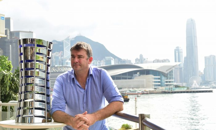 David Witt, skipper of the Sun Hung Kai entry for the Volvo Ocean Race 2017-18, standing beside the Volvo Ocean Race trophy at the Royal Hong Kong Yacht Club on Friday June 23. (Bill Cox/Epoch Times)