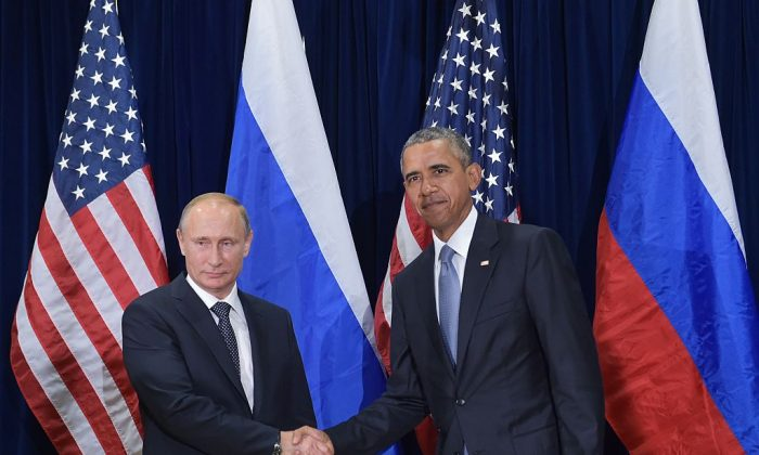 Former President Barack Obama and Russia's President Vladimir Putin shake hands while posing for a photo ahead of a bilateral meeting on the sidelines of the 70th session of the UN General Assembly at the United Nations headquarters  in New York on Sept. 28, 2015. (MANDEL NGAN/AFP/Getty Images)