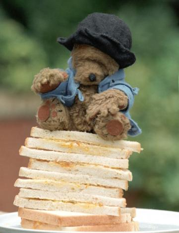 The original Paddington Bear which starred in dozens of BBC television programmes sits on a stack of marmelade sandwiches in London on April 29, 1997. (REUTERS/Dennis Owen)