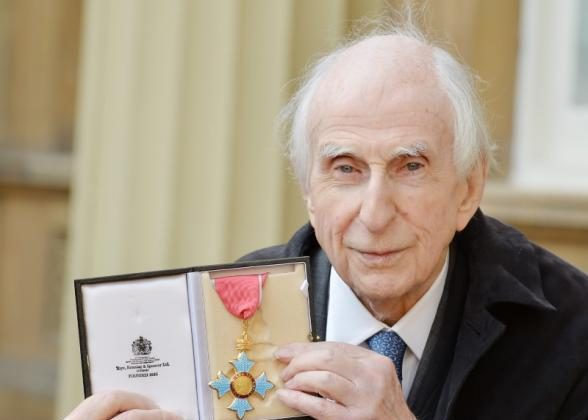 Michael Bond, who created Paddington Bear, holds his Commander of the Order of the British Empire (CBE) after it was presented to him by Prince William at an Investiture ceremony at Buckingham Palace in central London on October 27, 2015. (REUTERS/John Stillwell/Pool)