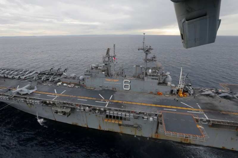 The USS Bonhomme Richard amphibious assault ship sails in the Pacific Ocean off the coast of Sydney, Australia, after a ceremony on board the ship marking the start of Talisman Saber 2017, a biennial joint military exercise between the United States and Australia,  June 29, 2017. REUTERS/Jason Reed