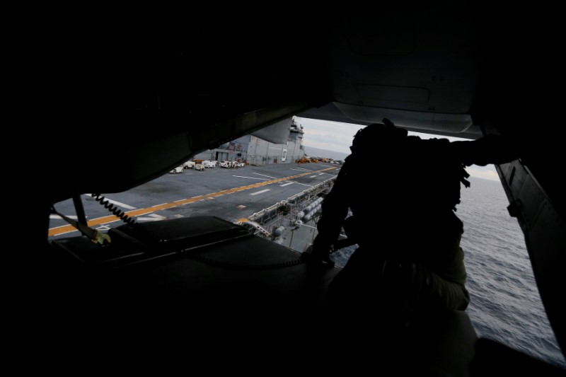 A crewman aboard a U.S. Marines MV-22B Osprey Aircraft looks out over the deck of the USS Bonhomme Richard amphibious assault ship before landing on it off the coast of Sydney, Australia, at the start of Talisman Saber 2017, a biennial joint military exercise between the United States and Australia June 29, 2017. REUTERS/Jason Reed