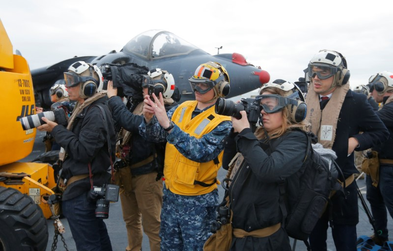 Journalists record activities aboard the USS Bonhomme Richard amphibious assault ship off the coast of Sydney, Australia, before a ceremony marking the start of Talisman Saber 2017, a biennial joint military exercise between the United States and Australia June 29, 2017. REUTERS/Jason Reed