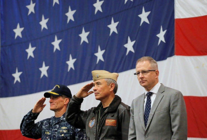 (L-R) U.S. Navy Rear Admiral Marc Dalton, Commander of the U.S. Pacific Command Admiral Harry Harris and Australian Minister for Urban Infrastructure Paul Fletcher participate in a ceremony marking the start of Talisman Saber 2017, a biennial joint military exercise between the United States and Australia aboard the USS Bonhomme Richard amphibious assault ship in the Pacific Ocean off the coast of Sydney, Australia, June 29, 2017. (REUTERS/Jason Reed)