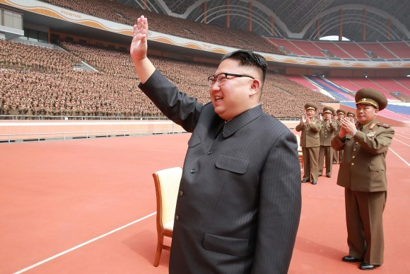 This undated picture released by North Korea's official Korean Central News Agency (KCNA) on May 15, 2017 shows North Korean leader Kim Jong-Un (L) waving to the Korean People's Army construction department officials in Pyongyang.         (STR/AFP/Getty Images)