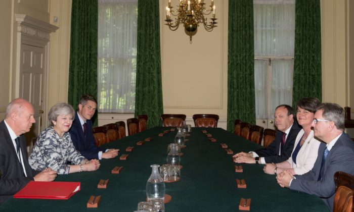 Prime Minister Theresa May (2L) sits with First Secretary of State Damian Green (L), and Parliamentary Secretary to the Treasury, and Chief Whip, Gavin Williamson (3L) as they talk with Democratic Unionist Party (DUP) leader Arlene Foster (2R), DUP Deputy Leader Nigel Dodds (3R), and DUP MP Jeffrey Donaldson, inside 10 Downing Street in London, England on June 26, 2017. (Daniel Leal-Olivas - WPA Pool /Getty Images)