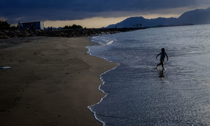 A kid plays on the beach on Dec. 13, 2014 in Banda Aceh, Indonesia. Aceh was the worst hit location, being the closest major city to the epicentre of the 9.1 magnitude quake, suffering a huge hit from the following tsunami and resulting in around 130,000 deaths. Throughout the affected region of eleven countries, nearly 230,000 people were killed, making it one of the deadliest natural disasters in recorded history. (Ulet Ifansasti/Getty Images)