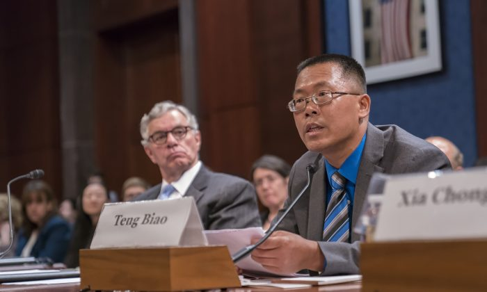 Teng Biao: Dr. Teng Biao, a Chinese human rights lawyer testifies on Wednesday's hearing held by Congressional-Executive Commission on China. (Leo Shi/The Epoch Times)