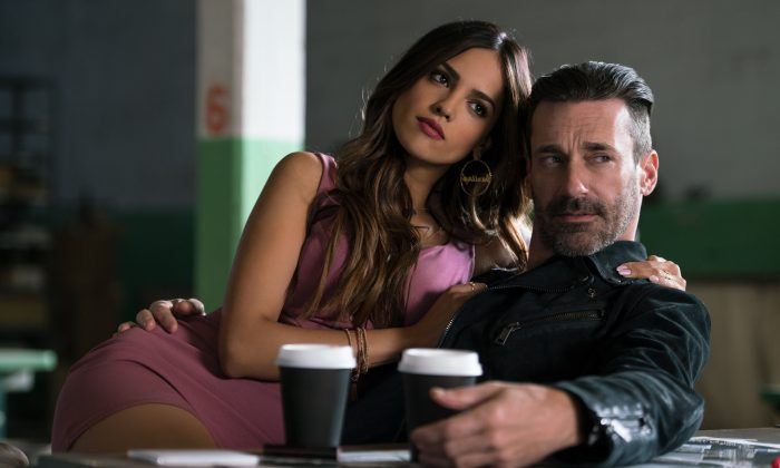 """(L–R) Darling (Eiza González) and Buddy (Jon Hamm) find out why Baby always listens to music in TriStar Pictures's """"Baby Driver."""" (Sony Pictures Entertainment Inc.)"""