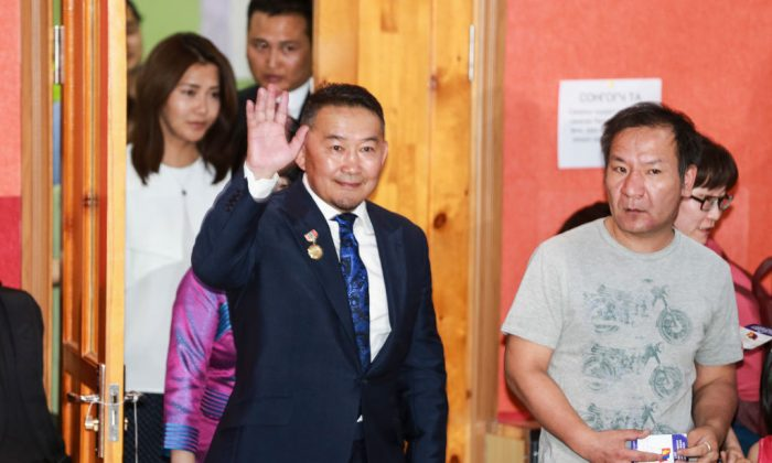 Khaltmaa Battulga, from the main opposition Democratic Party (DP), arrives to cast his ballot at a polling station during the Mongolian presidential election in Ulan Bator on June 26, 2017. (BYAMBAA BYAMBA-OCHIR/AFP/Getty Images)