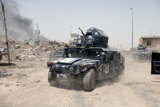 A military vehicle of the Emergency Response Division is seen during the fight with the Islamic States militants in the Old City of Mosul, Iraq, July 3, 2017. (REUTERS/Ahmed Jadallah)