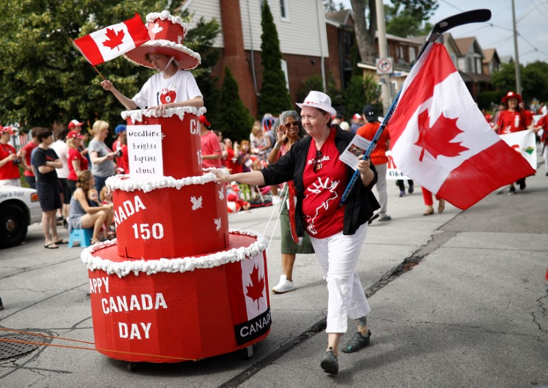 "People participate in the East York Toronto Canada Day parade, as the country marks its 150th anniversary with ""Canada 150"" celebrations, in Toronto, Ontario, Canada on July 1, 2017. (REUTERS/Mark Blinch)"