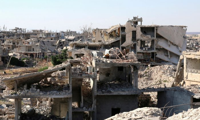 A general view shows damaged buildings in a rebel-held part of the southern city of Deraa, Syria on June 22, 2017. (REUTERS/Alaa Al-Faqir)