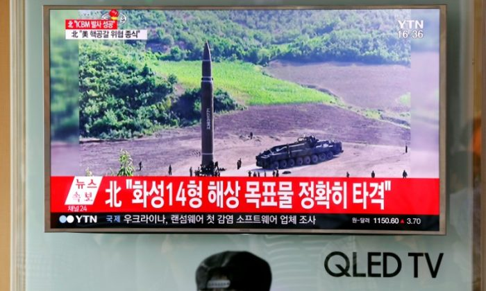 A man watches a TV broadcasting still photographs released by North Korea's state-run television KRT of North Korea's Hwasong-14 missile, at a railway station in Seoul, South Korea. (REUTERS/Kim Hong-Ji)