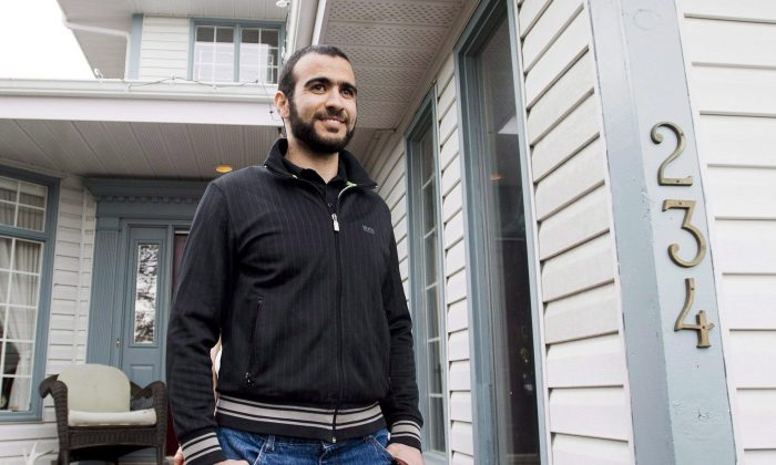 Omar Khadr walks out of his lawyer Dennis Edney's home to speak to the media in Edmonton, Alberta on May 7, 2015. (The Canadian Press/Nathan Denette)
