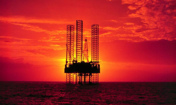 Pennzenergy Company oil exploration drilling rig In the Gulf of Mexico during Sunset. (Getty Images)