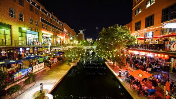 The Bricktown entertainment district at night. (Oklahoma City Convention & Visitors Bureau)