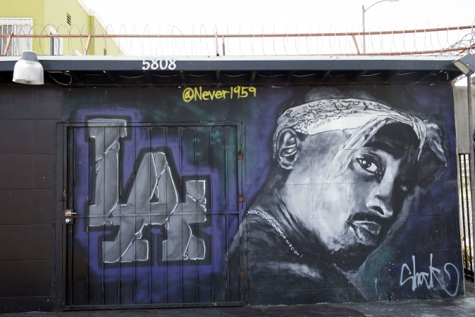 "A wall dedicated to the memory of US rapper Tupac Shakur is seen on May 26, 2016 in  Los Angeles, California.  Twenty years after his death, Tupac still reigns. Other rappers have succeeded him in stardom, and promotional efforts around Tupac have been haphazard, but the artist who died at age 25 on September 13, 1996, in Las Vegas, maintains a hold that is among the most enduring in recent times.  / AFP / VALERIE MACON / TO GO WITH AFP STORY by Shaun TANDON, ""20 years on, Tupac reigns as potent global force""        (Photo credit should read VALERIE MACON/AFP/Getty Images)"