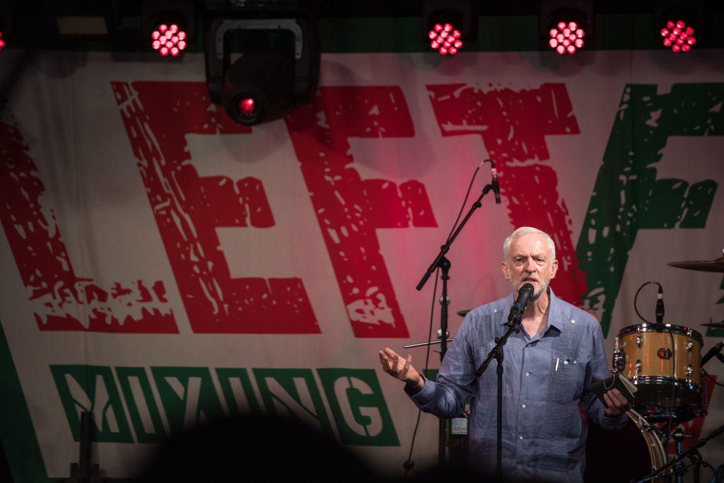 Labour Party leader Jeremy Corbyn speaks to crowds at Left Field Stage at Glastonbury Festival Site in Glastonbury, England on June 24, 2017. (Chris J Ratcliffe/Getty Images)