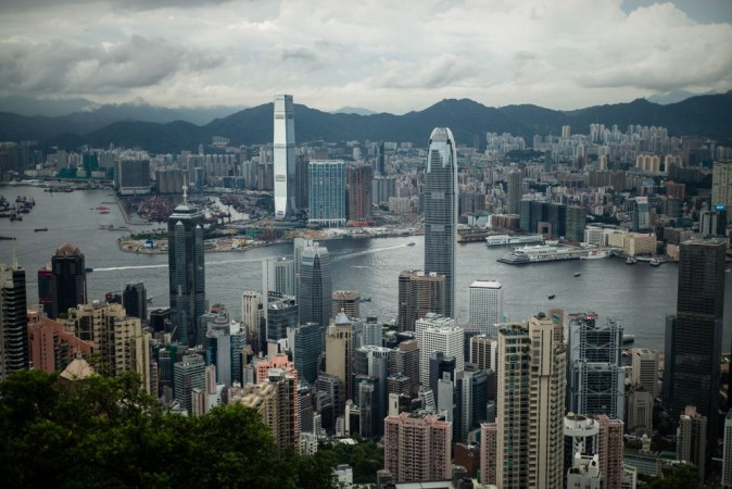Victoria Harbour and the skylines of the Kowloon district (background) and Hong Kong island (foreground) on July 3, 2017. (ANTHONY WALLACE/AFP/Getty Images)