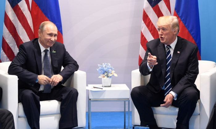US President Donald Trump and Russia's President Vladimir Putin hold a meeting on the sidelines of the G20 Summit in Hamburg, Germany, on July 7, 2017.(SAUL LOEB/AFP/Getty Images)