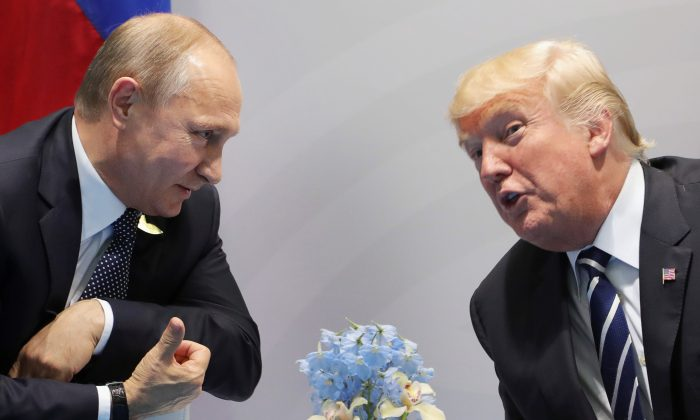 U.S. President Donald Trump and Russia's President Vladimir Putin speaks during their meeting on the sidelines of the G20 Summit in Hamburg, Germany, on July 7, 2017. Following the meeting, the U.S., Russia, and Jordan announced a ceasefire agreement for the southwestern portion of Syria to take effect on Sunday. (MIKHAIL KLIMENTIEV/AFP/Getty Images)
