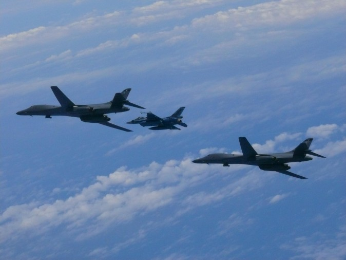 Two U.S. Air Force B-1B Lancers fly with a Koku Jieitai (Japan Air Self-Defense Force) F-2 fighter jet over the East China Sea, July 7, 2017. (Japan Air Self-Defense Force)