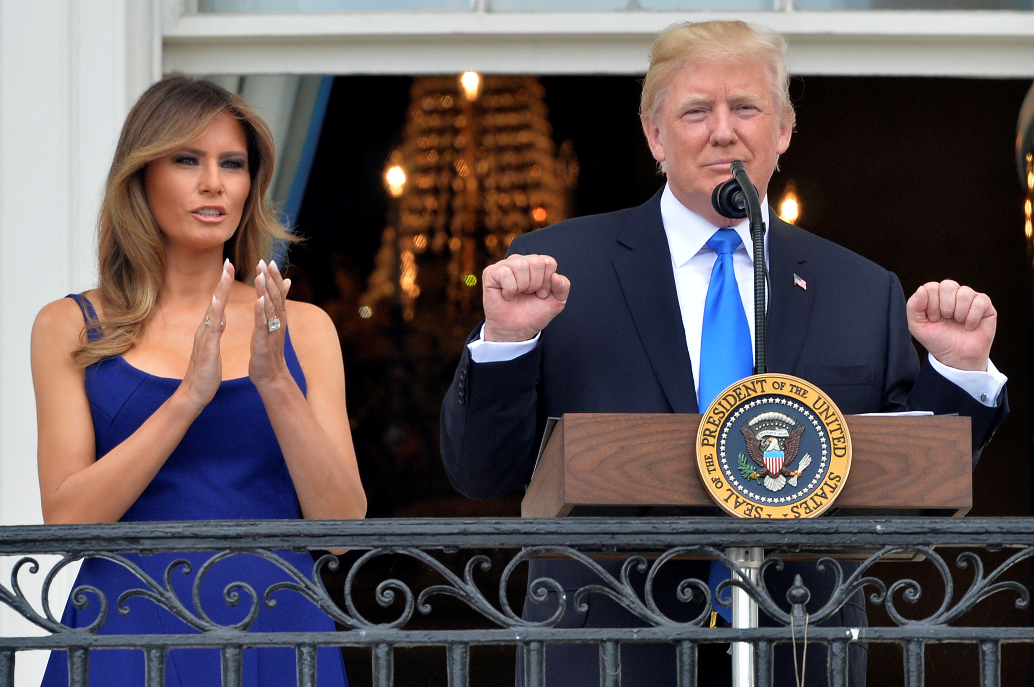 President Trump concludes his remarks while First Lady Melania Trump applauds as they welcome military families on the South Lawn of the White House. (REUTERS/Mike Theiler)