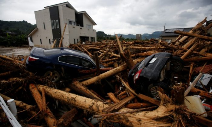Debris and cars which were swept by heavy rain are seen in Asakura, Fukuoka Prefecture, Japan July 8, 2017. (Reuters/Issei Kato)