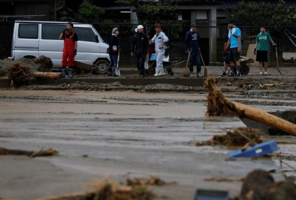 Local residents prepare to remove mud and debris which were swept by heavy rain in Asakura, Fukuoka Prefecture, Japan July 8, 2017. (Reuters/Issei Kato)